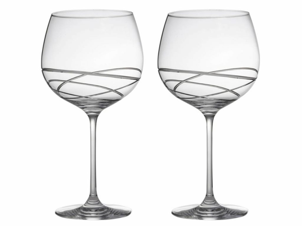 These stunning hand cut crystal Skye Copa Gin Glasses made by Royal Scot come with a beautiful pattern and presented in a lovely charcoal grey satin presentation box. Perfect Glass for the perfect Gin. Size: 780ml By: Royal Scot Crystal Product Code: SKYEB2GIN